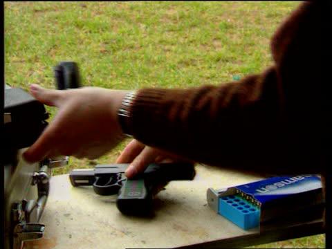 jill dando murder lib carmarthen ext cms 9mm semi automatic pistol as placed on table - pistolenschießen stock-videos und b-roll-filmmaterial