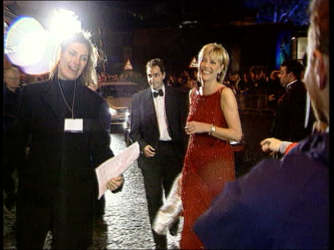 Man arrested then released LIB Royal Albert Hall Jill Dando towards for television awards ceremony wearing red sequinned dress followed by fiance Dr...
