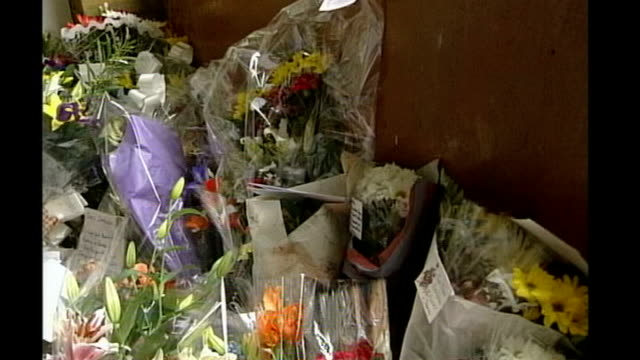 new forensic team on the case; november 2000 peckham: int floral tributes in stairwell where damilola taylor died - jill dando stock videos & royalty-free footage