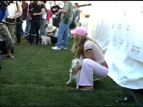 Jillian Barberie and Teddy at the 4th Annual Nuts For Mutts Event at Pierce College in Woodland Hills California on April 3 2005