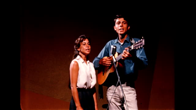 / Jim and Jean Glover sing and play guitar at the Troubadour café / EXT Troubadour at night Duo sing at the Troubadour café on January 01 1956 in...
