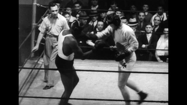 / Jim Braddock working out with punch bag / Jim Braddock and Joe Louis fight for the title / announcer proclaims knock out win for Louis but not...