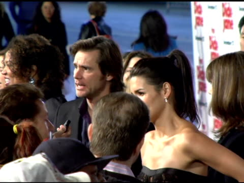 jim carrey and angie harmon at the 'fun with dick and jane' premiere at the mann village theatre in westwood, california on december 14, 2005. - angie harmon stock videos & royalty-free footage