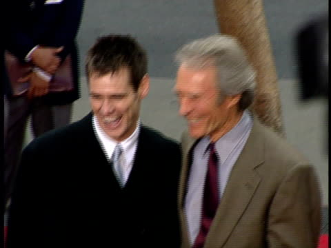 Jim Carrey and Clint Eastwood pose for photographs at presentation of his Star on the Hollywood Walk of Fame