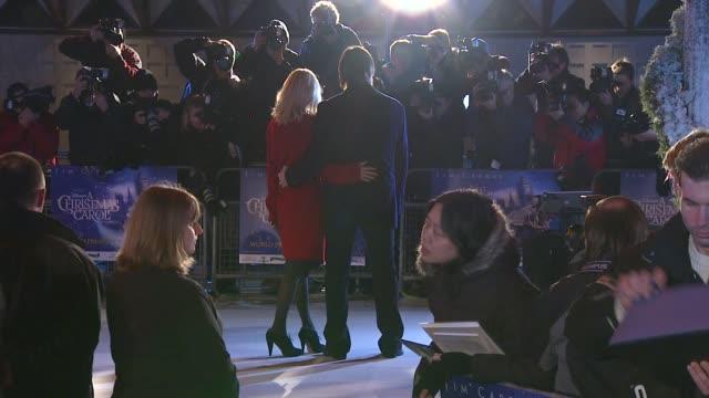 jim carrey and jenny mccarthy at the a christmas carol premiere and christmas lights at london england. - ジェニー・マッカーシー点の映像素材/bロール