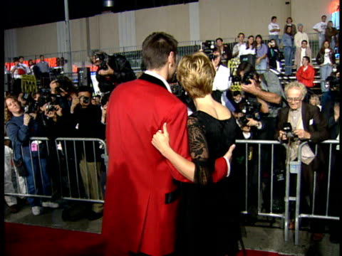 jim carrey and lauren holly pose for the press on the red carpet - lauren holly stock videos and b-roll footage