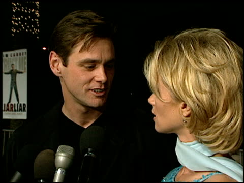 jim carrey at the 'liar liar' premiere at universal amphitheatre in universal city, california on march 18, 1997. - universal city video stock e b–roll