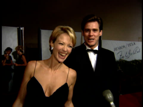 Jim Carrey Lauren Holly talk about the event