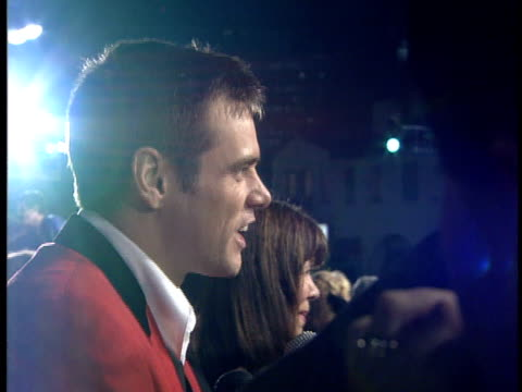 Jim Carrey speaks to a reporter on the red carpet