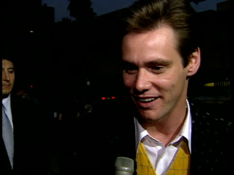 Jim Carrey talks to reporter on red carpet about the film wanting to play different roles and training on In Living Color