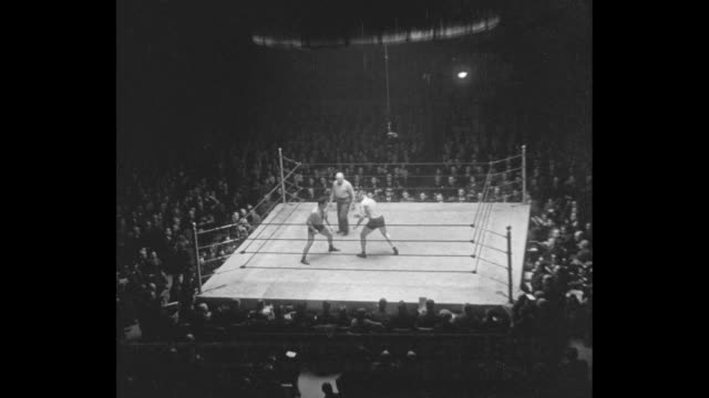 vs jim golden greek londos wrestles with jim mcmillen for the heavyweight wrestling title in arena at madison square garden - heavyweight stock videos and b-roll footage
