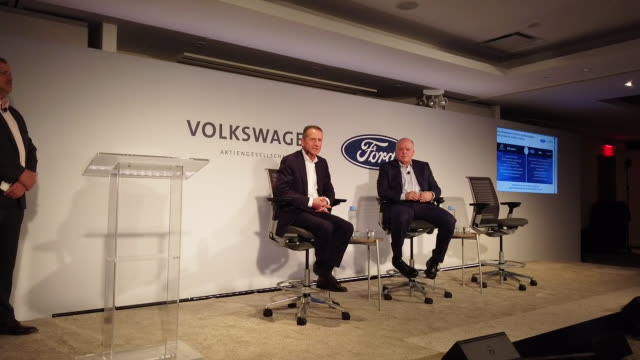 jim hackett , ceo of ford, and herbert diess, ceo of vw, sit together on stage to announce a new partnership between the two auto giants on july 12,... - ford motor company stock videos & royalty-free footage