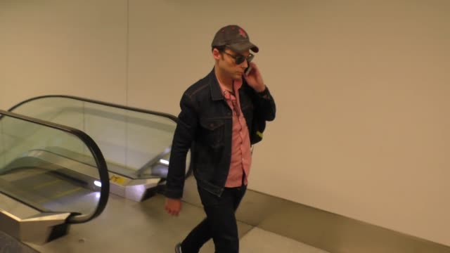 jim parsons departing at lax airport in los angeles in celebrity sightings in los angeles - jim parsons stock videos and b-roll footage