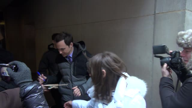 jim parsons exits the today show in rockefeller center and signs for a fan in celebrity sightings in new york - jim parsons stock videos and b-roll footage