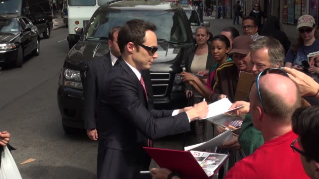 jim parsons signs for fans outside of the late show with david letterman in celebrity sightings in new york - jim parsons stock videos and b-roll footage