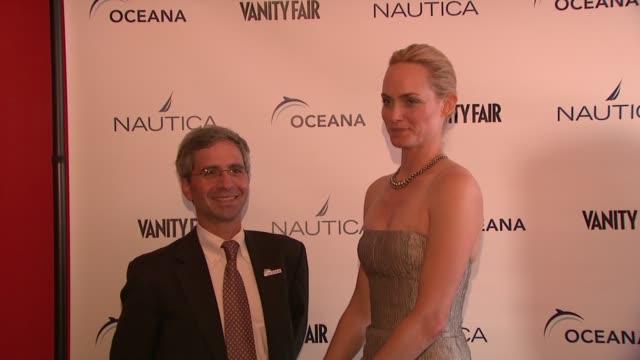 jim simon and amber valletta at the oceana nautica vanity fair celebrate world oceans day at new york ny - oceana stock videos & royalty-free footage