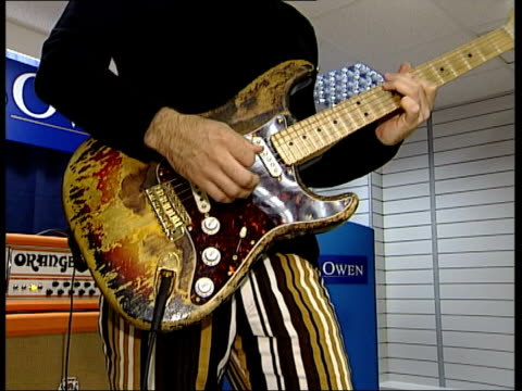 vídeos y material grabado en eventos de stock de jimi hendrix guitar to be auctioned itn london fender stratocaster guitar formerly owned by jimi hendrix played by dweezil zappa sot cms paint... - jimi hendrix