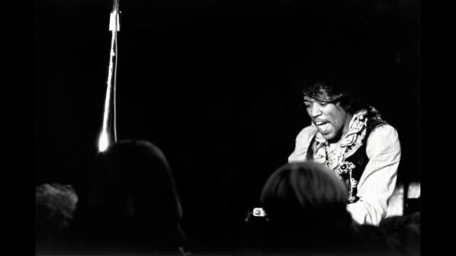 vídeos de stock, filmes e b-roll de gif jimi hendrix performs onstage at the monterey pop festival on june 18 1967 in monterey california - 1967