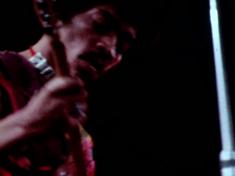 jimi hendrix playing guitar on stage at the isle of wight pop festival - isle of wight stock videos & royalty-free footage