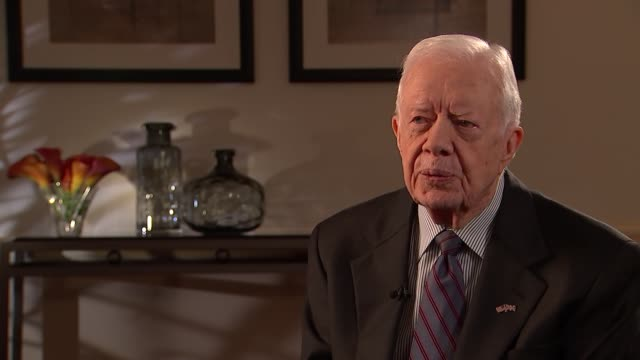jimmy carter interview on disease control; england: london: int jimmy carter into room, welcomed by jon snow and both sit for interview jimmy carter... - jimmy carter us president stock videos & royalty-free footage