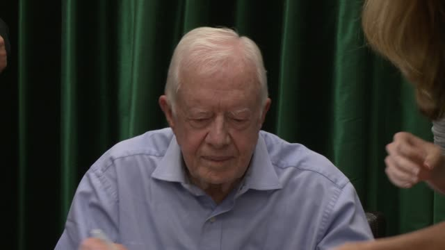 "jimmy carter signing books at the former president jimmy carter book signing for ""a full life: reflections at ninety"" at vroman's bookstore on july... - jimmy carter us president stock videos & royalty-free footage"