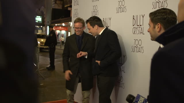 ms jimmy fallon with ad miles posing for paparazzi and talking to reporter along the red carpet at the imperial theater - jimmy fallon stock videos and b-roll footage