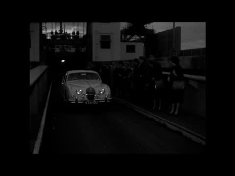 dover crosschannel boat approaches at dover ms name plane compiegne ms jimmy greaves and wife in car towards at quayside ms ditto car away gs greaves... - itv evening bulletin stock videos & royalty-free footage