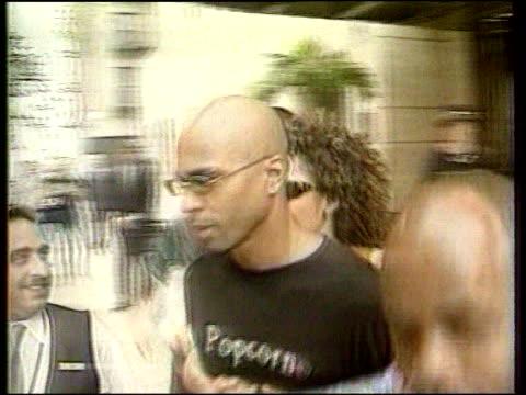 jimmy gulzar court case; england: london: ext bv dancer jimmy gulzar away towards car with his then wife spice girl mel b holding his waist lib - waist stock videos & royalty-free footage