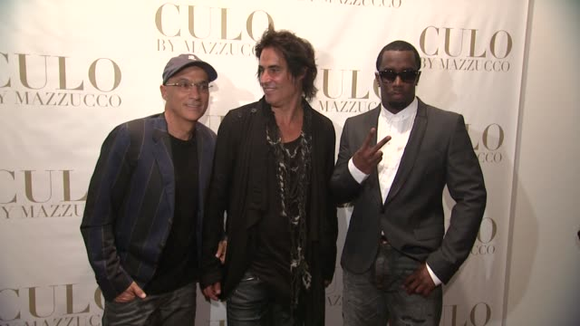 Jimmy Iovine Raphael Muzzucco and Sean Diddy Combs at the 'CULO By Mazzucco' Launch at New York NY