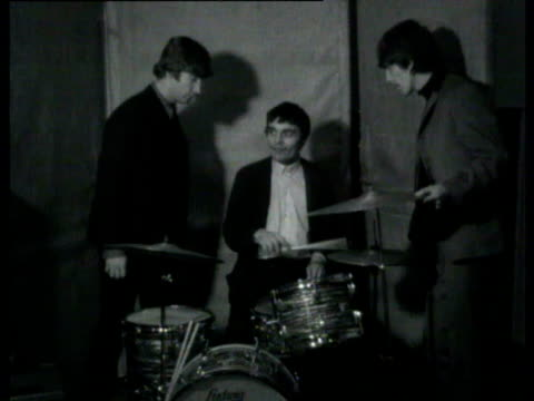 jimmy nichol playing drums and is joined by other beatles: paul mccartney, george harrison and john lennon / other beatles posing with guitars around... - paul mccartney stock videos & royalty-free footage