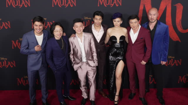 jimmy o yang jessica henwick rich brian at the world premiere of disney's mulan - gif stock videos & royalty-free footage