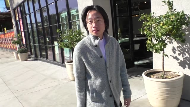 jimmy o. yang shares thoughts on oscar winner parasite while out on melrose place in west hollywood in celebrity sightings in los angeles, - west hollywood stock-videos und b-roll-filmmaterial