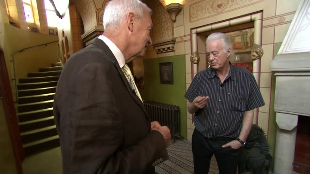 jimmy page in planning clash with robbie williams uk london jimmy page showing reporter around his home the tower house designed by william burges... - tower of babel stock videos and b-roll footage