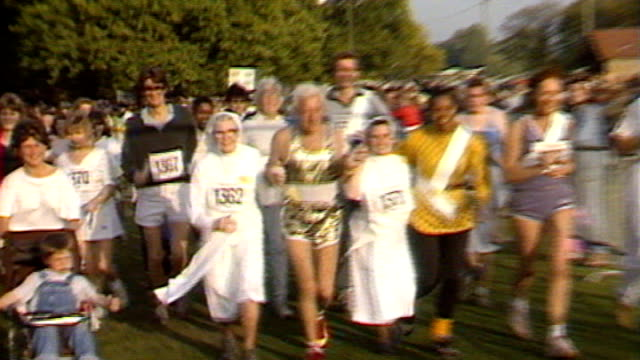 jimmy savile abuse claims / bbc responds to claims of abuse at television centre 138743 / tx ext jimmy savile taking part in funrun with group of nuns - running shorts stock videos & royalty-free footage