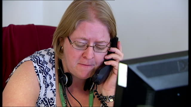 DPP to review decision not to press charges ENGLAND INT People wearing telephone headsets in NSPCC call centre with 'Save this number 0808 800 5000'...