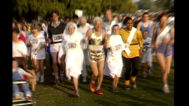 jimmy savile abuse scandal: dpp to review decision not to press charges; 138743 / tx 28.9.1986 london: hyde park: ext savile taking part in fun-run... - running shorts stock videos & royalty-free footage