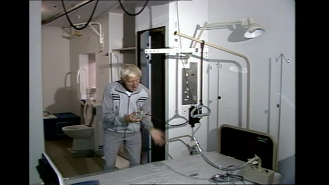 reports reveal extent of sexual abuse tx jimmy savile demonstrating lifting equipment over bed on hospital ward - ジミー サヴィル点の映像素材/bロール