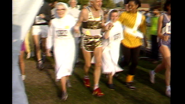 editor of bbc's newsnight steps aside; 138743 / tx 28.9.1986 england: london: hyde park: ext jimmy savile taking part in fun-run with nuns - running shorts stock videos & royalty-free footage