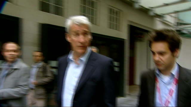 editor of bbc's newsnight steps aside; england: london: bbc broadcasting house: ext jeremy paxman responding to unseen reporter's questions as he... - jeremy paxman stock videos & royalty-free footage