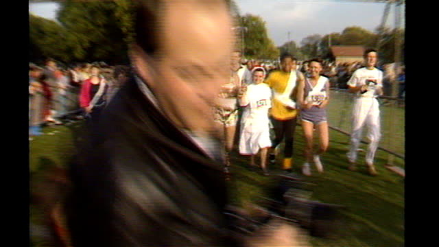 family speak out; 138743 / tx 28.9.1986 england: london: hyde park: ext jimmy savile taking part in fun-run with nuns - running shorts stock videos & royalty-free footage