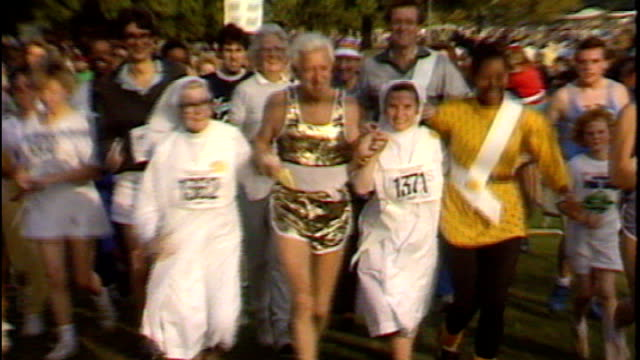 family speak out tx england london hyde park ext jimmy savile taking part in funrun with nuns - running shorts stock videos & royalty-free footage