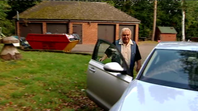Freddie Starr questioned for second time DAY Freddie Starr with Sophie Lea he walks away and gets into car LIB / TX Various shots Freddie Starr...