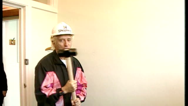 hospital abuse allegations come to light date jimmy savile knocking down wall with sledge hammer in hospital - ジミー サヴィル点の映像素材/bロール