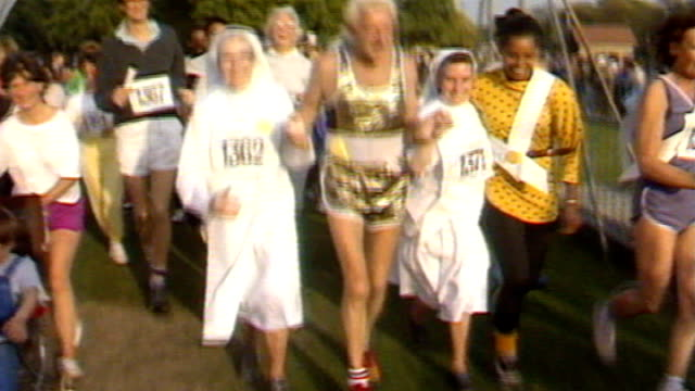 police identify more than 200 potential victims 138743 / tx england london hyde park ext jimmy savile taking part in funrun with nuns - running shorts stock videos & royalty-free footage