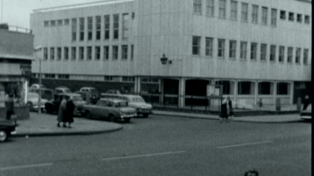 report reveals police failings; x17036503 / tx 17.3.1965 england: london: shepherd's bush: ext b/w footage: traffic along to shepherd's bush police... - filing cabinet stock videos & royalty-free footage