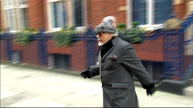 detectives investigate 31 rape claims lib london gary glitter and solicitor from building to car as he prepares to travel to police station to be... - gary glitter stock videos & royalty-free footage