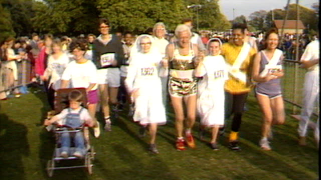 jimmy savile's coffin goes on display prior to his funeral; 138743 / tx 28.9.1986 hyde park: ext savile taking part in fun-run with group of nuns - running shorts stock videos & royalty-free footage