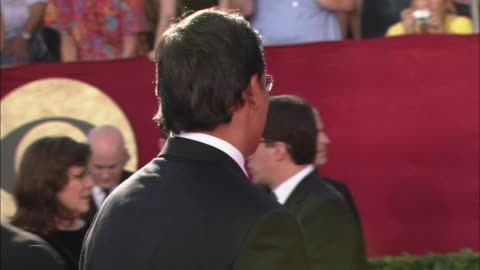 jimmy smits walking along red carpet waving to fans, speaking to organizer & then making his way over to talk to reporter - jimmy smits stock videos & royalty-free footage