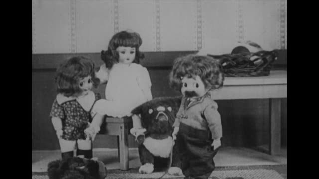 Jimmy the doll is chased by a dog doll