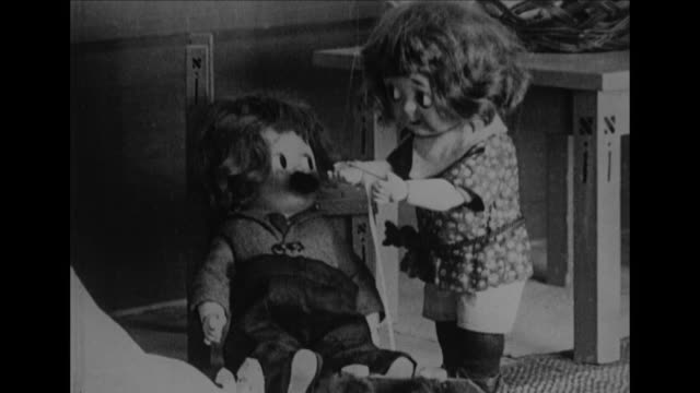 jimmy the doll is restless as billy the doll gives him a new look - restlessness stock videos and b-roll footage